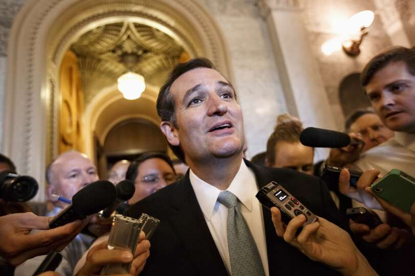 Sen. Ted Cruz, R-Texas talks to reporters as he emerges from the Senate Chamber on Capitol Hill in W
