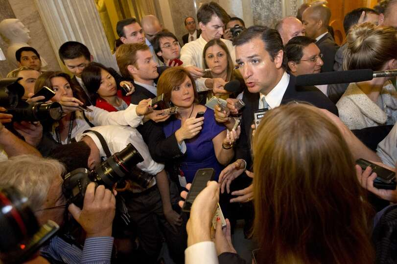 Sen. Ted Cruz, R-Texas, right, speaks to the media after leaving a marathon speech on the Senate flo