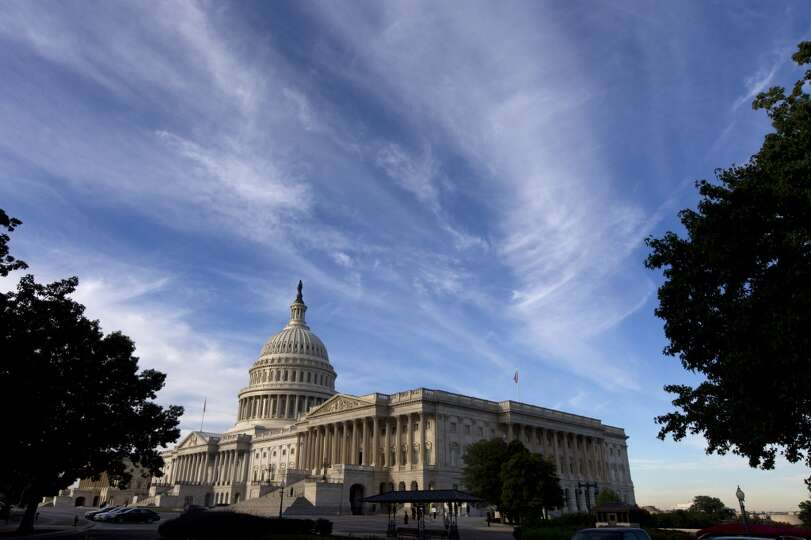 Cirrus clouds float high above the Capitol in Washington, Wednesday, Sept. 25, 2013, as Sen. Ted Cru