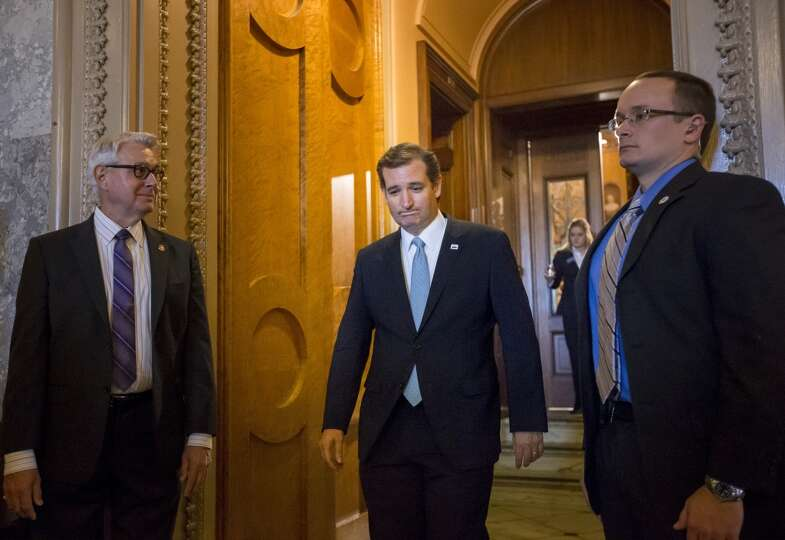 Sen. Ted Cruz, R-Texas emerges from the Senate Chamber on Capitol Hill in Washington, Wednesday, Sep