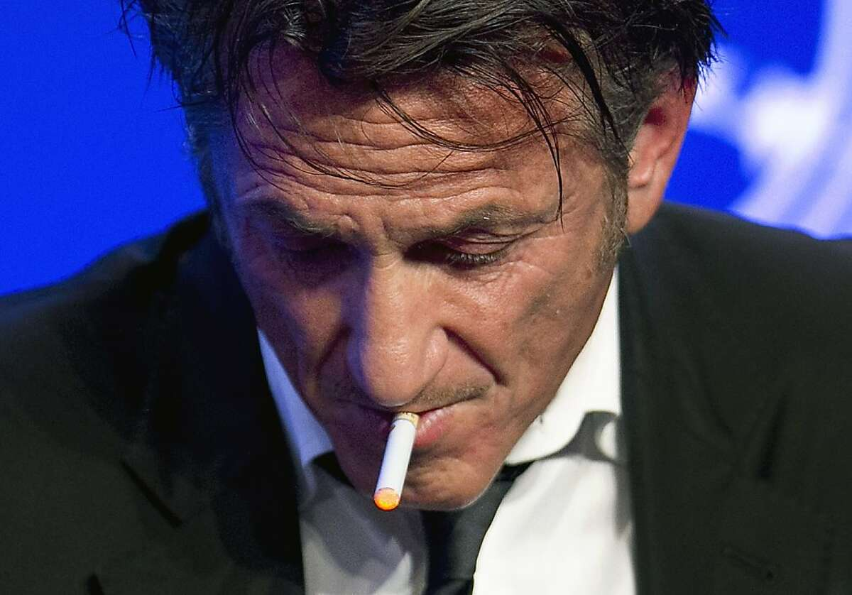 WTF: Sean Penn smokes an e-cigarette during the panel discussion
