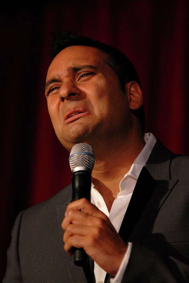 """WEST HOLLYWOOD, CA - NOVEMBER 07:  Comedian Russell Peters entertains the audience at the """"Heart & Soul: An Evening of High Comedy and Low Cholesterol"""" benefit for the Larry King Cardiac Foundation at BOA Steakhouse on November 7, 2009 in West Hollywood, California.  (Photo by Michael Tullberg/Getty Images for COPE Health Solutions) Photo: Michael Tullberg / 2009 Getty Images"""