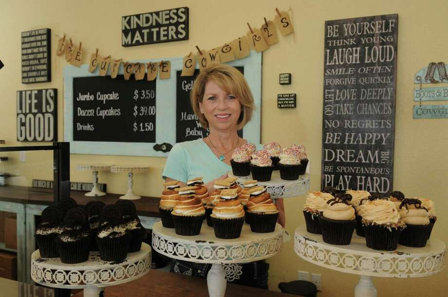 Rebecca Clanton, shows off some of her edible artistry at her bakery, Cupcake Cowgirls in Spring.  The Food Network Cupcake Wars champion is opening her first franchise open Oct. 1 in College Park Plaza on Texas 242 in The Woodlands. Photo: Jerry Baker, Freelance