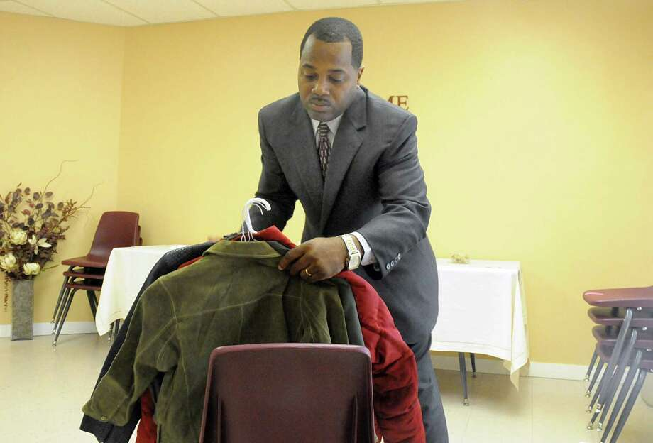 Brett James collects coats from parishioners at The Woodlands Impact Church, 5401 Shadowbend Place. The annual coat drive benefits the youth at Covenant House Texas. Photo: David Hopper, Freelance / freelance