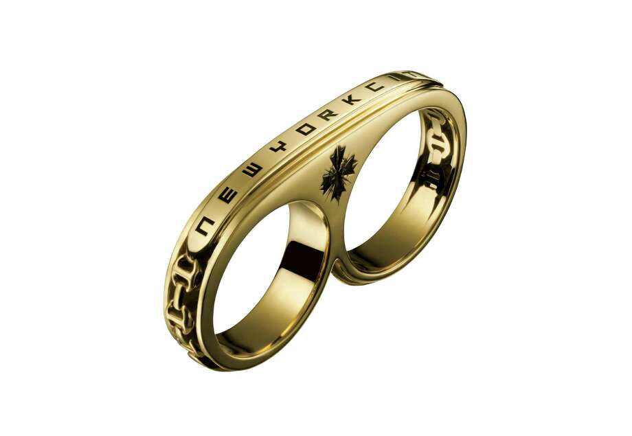 This product image released by Barneys shows a Hoorsenbuhs ring from a collection of items by Jay-Z. The music mogul is partnering with Barneys to offer a limited-edition of Jay-Z designs for the holidays. A quarter of sales will go to Jay-Z's Shawn Carter Foundation, which helps low-income students cover college costs. The Jay-Z collection will be available beginning Nov. 20. (AP Photo/Barneys) ORG XMIT: NYET311 / Barneys