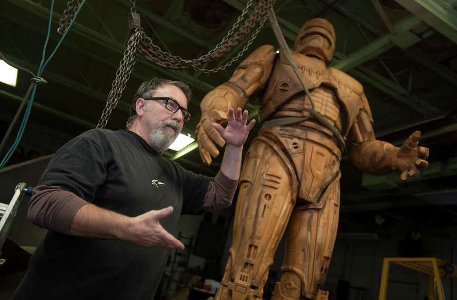 Giorgio Gikas, president of Venus Bronze Works, talks about a foam model of the the fictional crime-fighting cyborg RoboCop statue inside Venus Bronze Works in Detroit , Michigan on Tuesdat, Sept. 24, 2013.  Venus Bronze Works in Detroit is getting ready to cast pieces of the statue. After this model is turned into a mold, the finished statue is set to be unveiled in summer of 2014. The 1980s science fiction movie was set in a futuristic and crime-ridden Detroit. (AP Photo/The Detroit News, David Guralnick )    ORG XMIT: MIDTN101 Photo: David Guralnick / The Detroit News