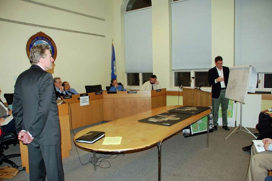 Rich Terhune, a church neighbor, standing left, listens to Craig Flaherty, a design engineer, far right, answer questions about the work planned at Noroton Presbyterian Church at the Sept. 24 Planning and Zoning Commission meeting. Photo by Jarret Liotta for the Darien News Photo: Contributed Photo