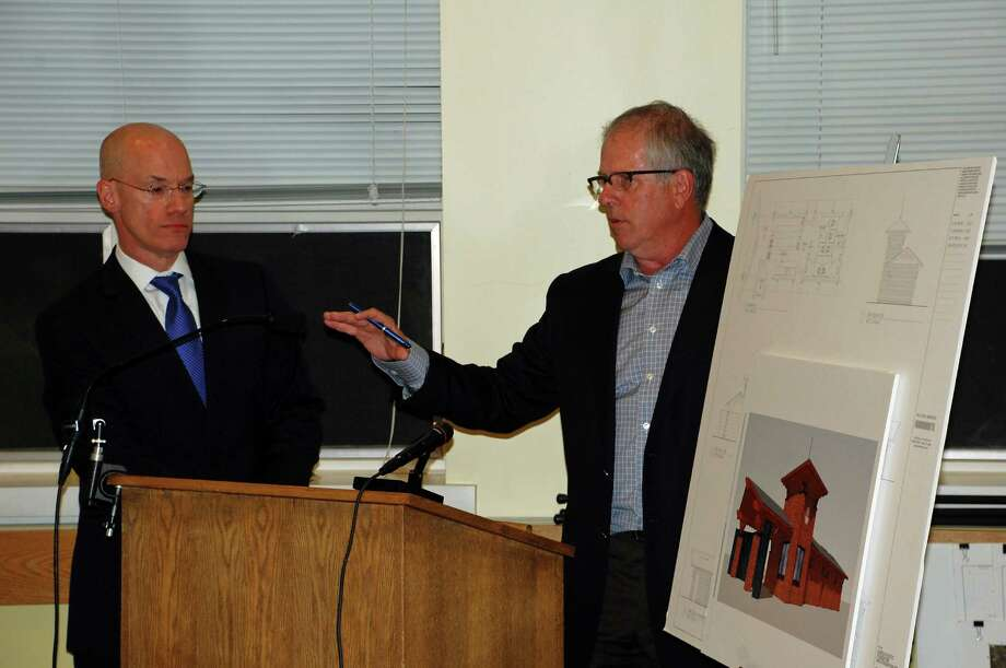 Attorney Bruce Hill, left, listen to architect Neil Hauck discuss the new pavilion the Darien Athletic Foundation wants to build at the Darien High School stadium at the Sept. 24 Planning and Zoning Commission meeting. Photo by Jarret Liotta for the Darien News Photo: Contributed Photo