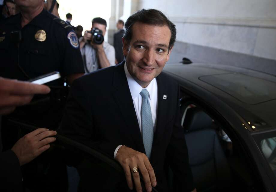 WASHINGTON, DC - SEPTEMBER 25:  Followed by members of the media, U.S Sen. Ted Cruz (R-TX) leaves the Capitol after he spoke on the Senate floor for more than 21 hours September 25, 2013 on Capitol Hill in Washington, DC. Sen. Cruz ended his marathon speech against the Obamacare at noon on Wednesday.  (Photo by Alex Wong/Getty Images) Photo: Getty Images