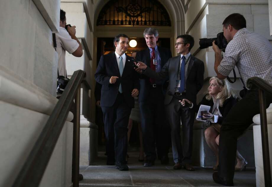 WASHINGTON, DC - SEPTEMBER 25:  Followed by members of the media, U.S Sen. Ted Cruz (R-TX) (L) leaves the Capitol after he spoke on the Senate floor for more than 21 hours September 25, 2013 on Capitol Hill in Washington, DC. Sen. Cruz ended his marathon speech against the Obamacare at noon on Wednesday.  (Photo by Alex Wong/Getty Images) Photo: Getty Images