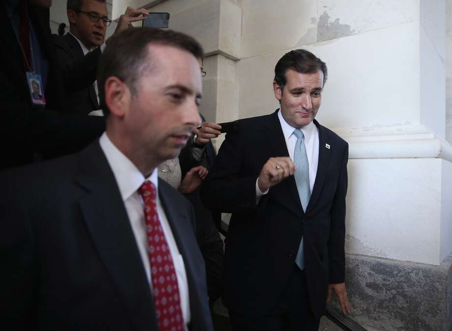 WASHINGTON, DC - SEPTEMBER 25:  Followed by members of the media, U.S Sen. Ted Cruz (R-TX) (R) leaves the Capitol after he spoke on the Senate floor for more than 21 hours September 25, 2013 on Capitol Hill in Washington, DC. Sen. Cruz ended his marathon speech against the Obamacare at noon on Wednesday.  (Photo by Alex Wong/Getty Images) Photo: Getty Images