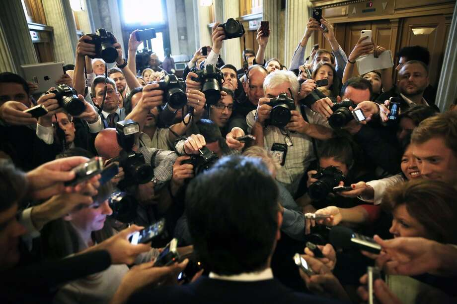 WASHINGTON, DC - SEPTEMBER 25:  U.S Sen. Ted Cruz (R-TX) (C) speaks to members of the media as he comes out from the Senate Chamber after he spoke on the floor for more than 21 hours September 25, 2013 on Capitol Hill in Washington, DC. Sen. Cruz ended his marathon speech against the Obamacare at noon on Wednesday.  (Photo by Alex Wong/Getty Images) Photo: Getty Images