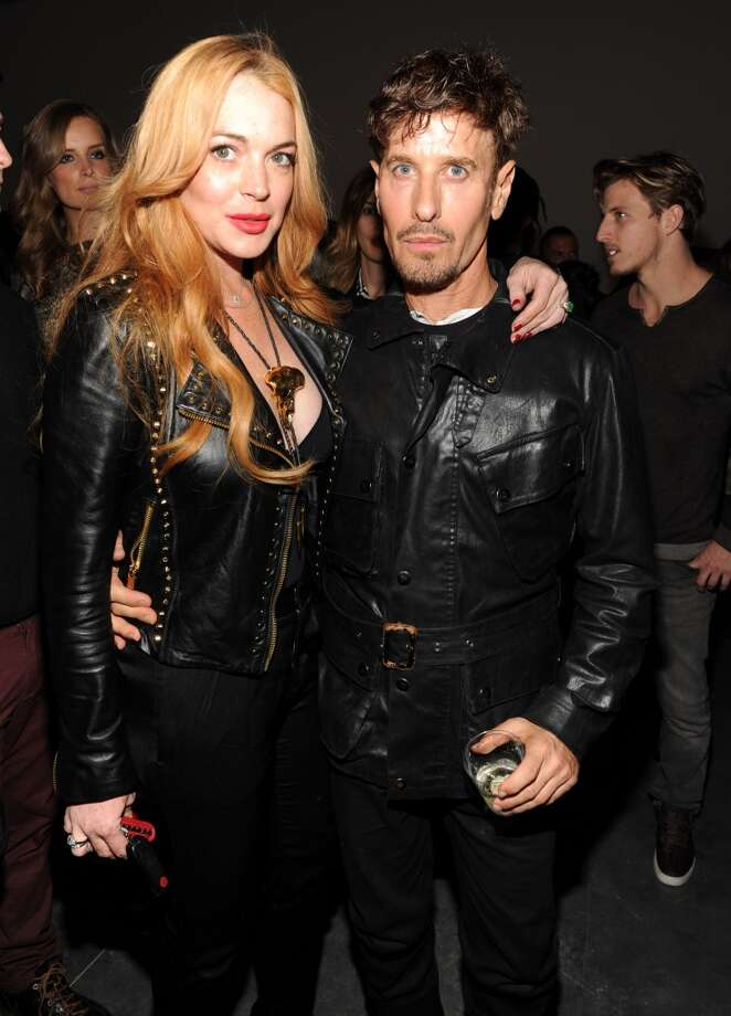 Lindsay Lohan and Steven Klein attend Madonna and Steven Klein secretprojectrevolution at the Gagosian Gallery on September 24, 2013 in New York City.  (Photo by Kevin Mazur/Getty Images) Photo: Kevin Mazur, Getty Images