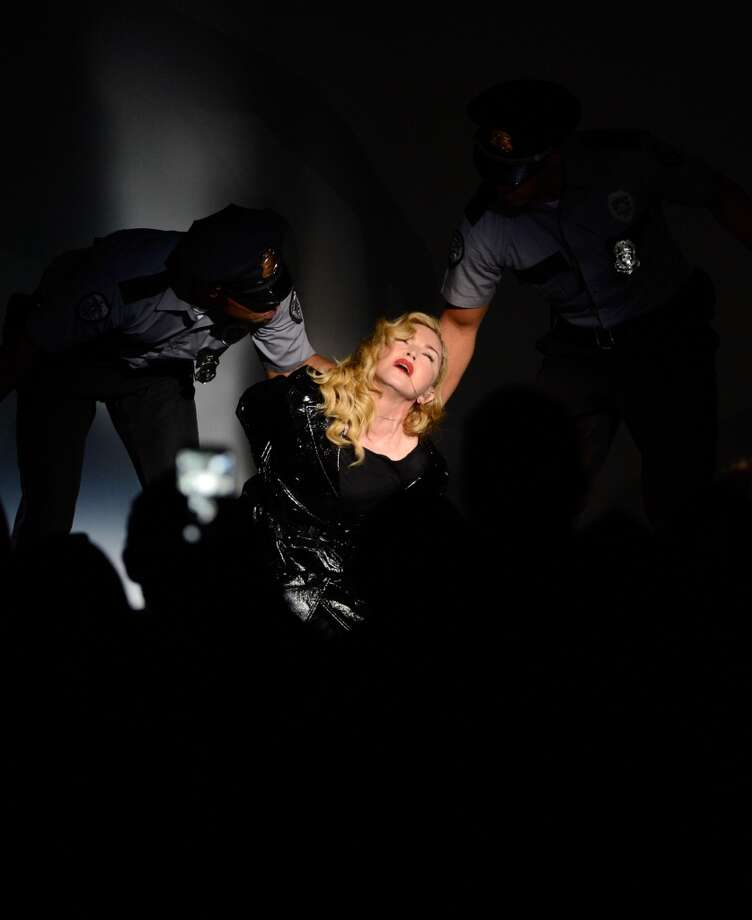 Madonna performs during Madonna and Steven Klein secretprojectrevolution at the Gagosian Gallery on September 24, 2013 in New York City.  (Photo by Kevin Mazur/Getty Images) Photo: Kevin Mazur, Getty Images
