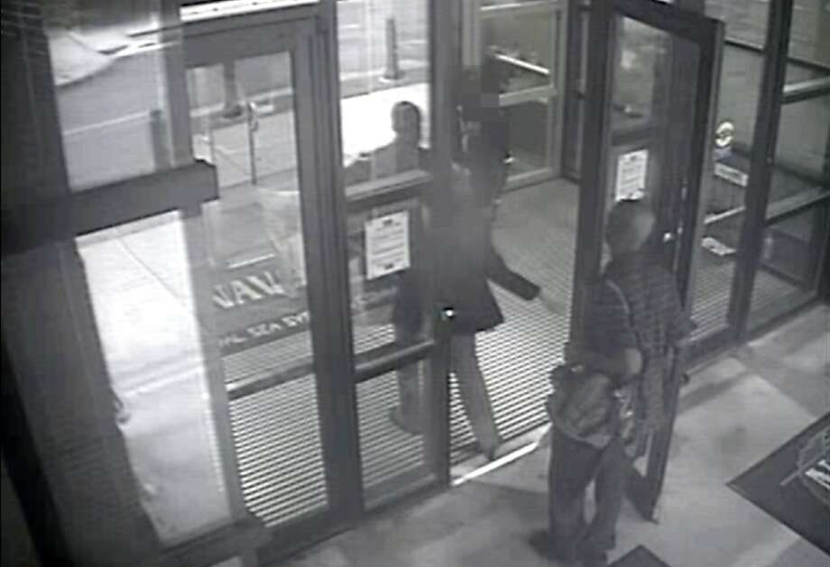 An image from video shows Aaron Alexis entering the building. Photo: Associated Press