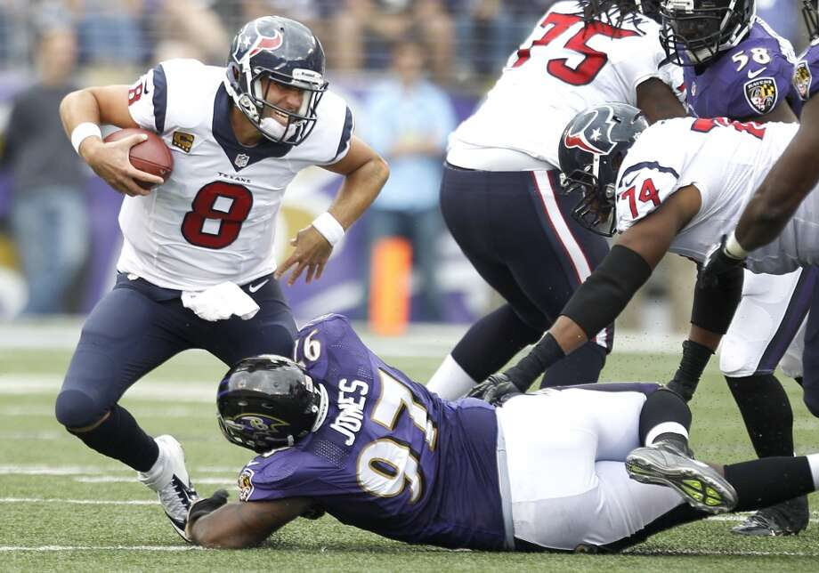 Texans quarterback Matt Schaub is sacked by Ravens defensive end Arthur Jones. Photo: Brett Coomer, Houston Chronicle