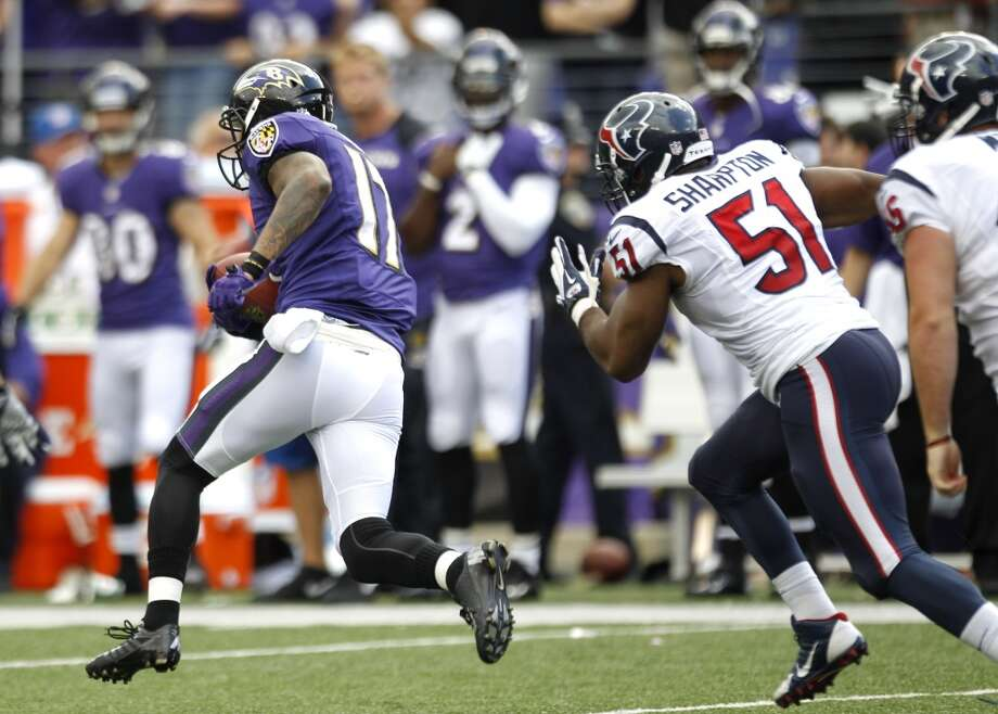 Ravens wide receiver Tandon Doss (17) breaks away from Texans inside linebacker Darryl Sharpton (51) on his way to an 82-yard punt return for a touchdown. Photo: Brett Coomer, Houston Chronicle