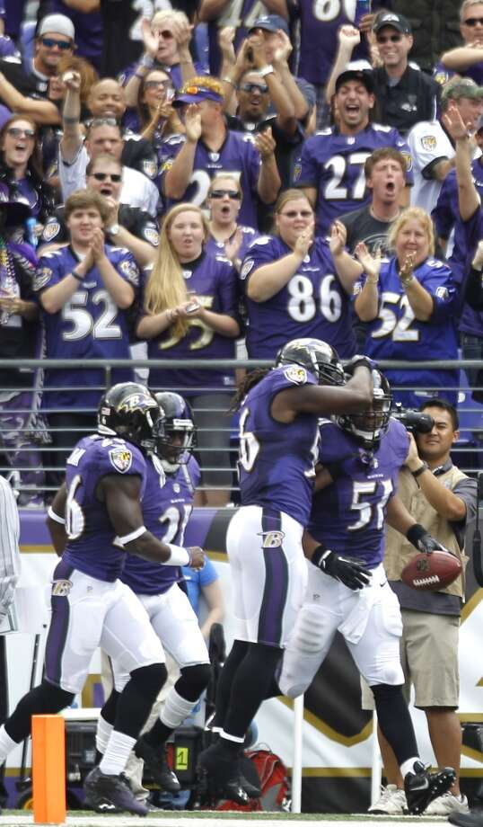 Ravens inside linebacker Daryl Smith (51) and Ravens inside linebacker Josh Bynes (56) celebrate Smith's TD on after an interception of Matt Schaub. Photo: Brett Coomer, Houston Chronicle