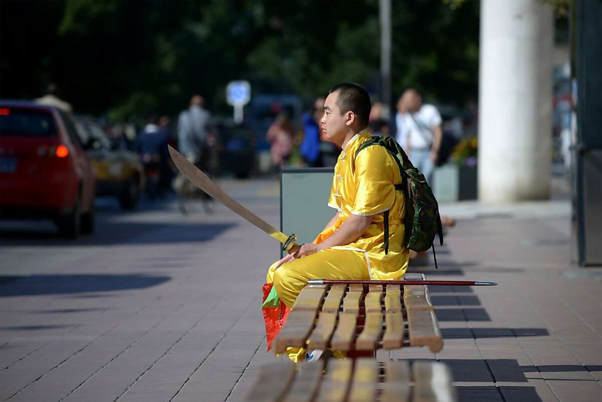 Maybe it's your deodorant: A Chinese martial arts enthusiast rests on a bench in Beijing, wondering why no one will sit near him.