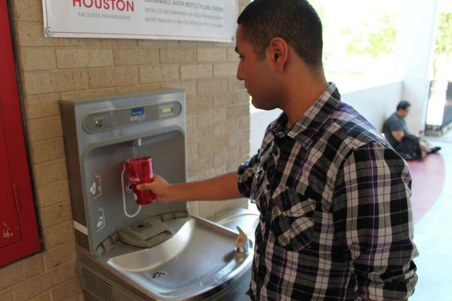 University of Houston freshman Josue Luviano is refilling his UH cup at one of the new filtered-water stations. Photo: University Of Houston