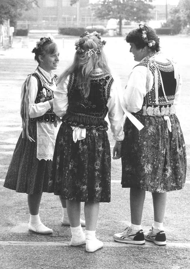 Chatting on Oct. 2, 1988, before marching to Holy Name of Jesus Church for Mass and then traveling to the Pulaski Day Parade in New York City are, from left, Natalia Vaughan, 13, Jacqueline Striano, 14, and Angie Errico, 13. Photo: Advocate