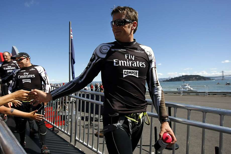 Emirates skipper Dean Barker is greeted by fans during the dock out show before the start of race number 19 of the America's Cup Finals in San Francisco, CA Wednesday September 25, 2013. Photo: Michael Short, The Chronicle