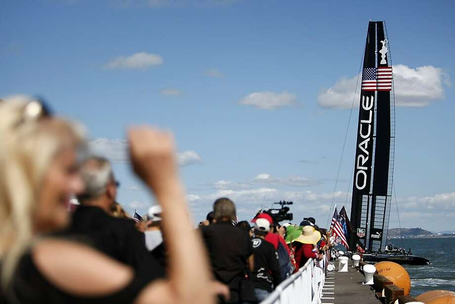 Fans watch as Oracle's AC72 leaves it's moorings before the start of race number 19 of the America's Cup Finals in San Francisco, CA Wednesday September 25, 2013. Photo: Michael Short, The Chronicle