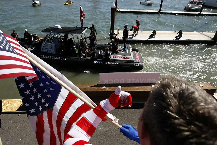 Fans cheer during the dock out show before the start of race number 19 of the America's Cup Finals in San Francisco, CA Wednesday September 25, 2013. Photo: Michael Short, The Chronicle