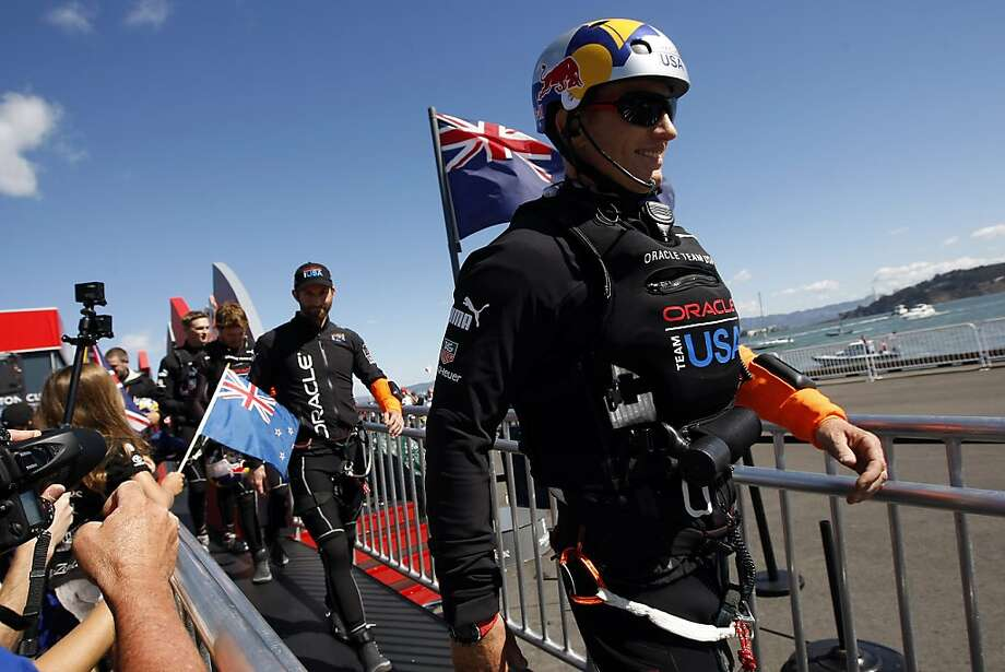 Oracle skipper Jimmy Spithill is greeted by fans during the dock out show before the start of race number 19 of the America's Cup Finals in San Francisco, CA Wednesday September 25, 2013. Photo: Michael Short, The Chronicle