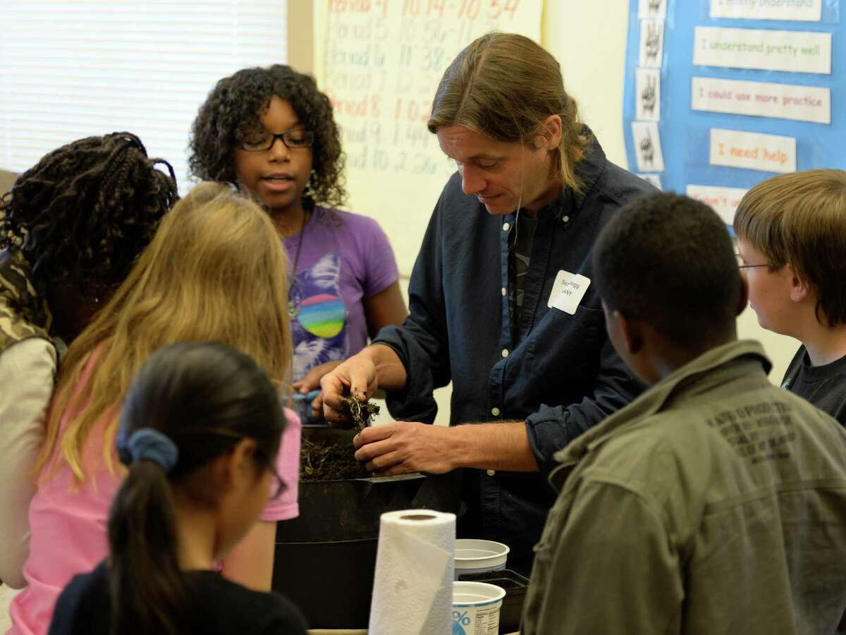 Scott Kellogg, education director at the Radix Ecological Sustainability Center at the University at Albany, shows Hackett Middle School students a worm composting bin Wednesday, Sept. 25, 2013, during the Taste of College: College and Career Readiness Workshop at Hackett Middle School in Albany, N.Y. (Skip Dickstein / Times Union)