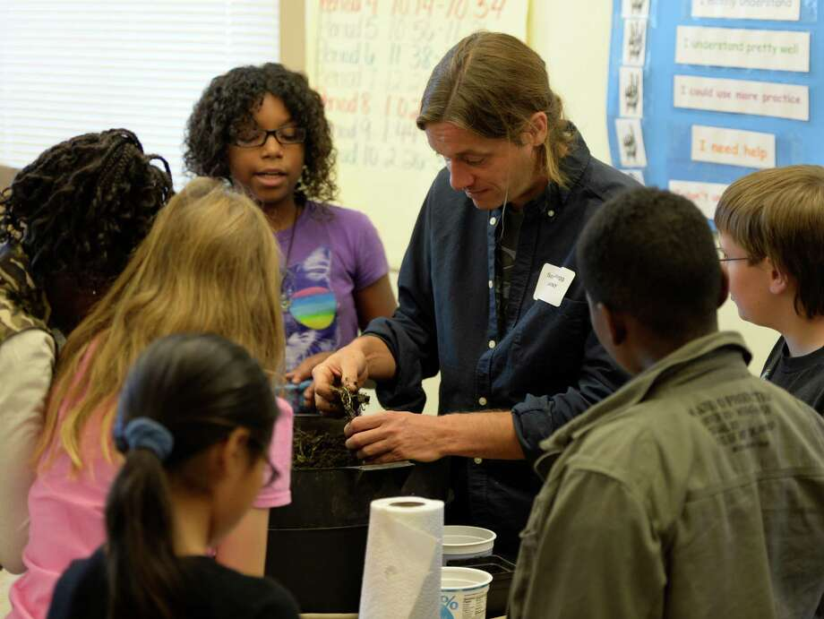 Scott Kellogg, education director at the Radix Ecological Sustainability Center at the University at Albany, shows Hackett Middle School students a worm composting bin Wednesday, Sept. 25, 2013, during the Taste of College: College and Career Readiness Workshop at Hackett Middle School in Albany, N.Y. (Skip Dickstein / Times Union) Photo: Skip Dickstein