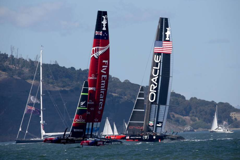 Emirates Team New Zealand skippered by Dean Barker and Oracle Team USA skippered by James Spithill compete during the final race of the America's Cup on September 25, 2013 in San Francisco, California. Photo: Justin Sullivan, Getty Images
