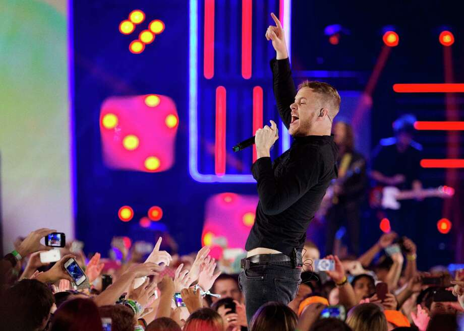 Dan Reynolds of Imagine Dragons performs during We Day in Toronto, on Friday Sept. 20, 2013. (AP Photo/The Canadian Press, Mark Blinch) Photo: Mark Blinch, SUB / The Canadian Press