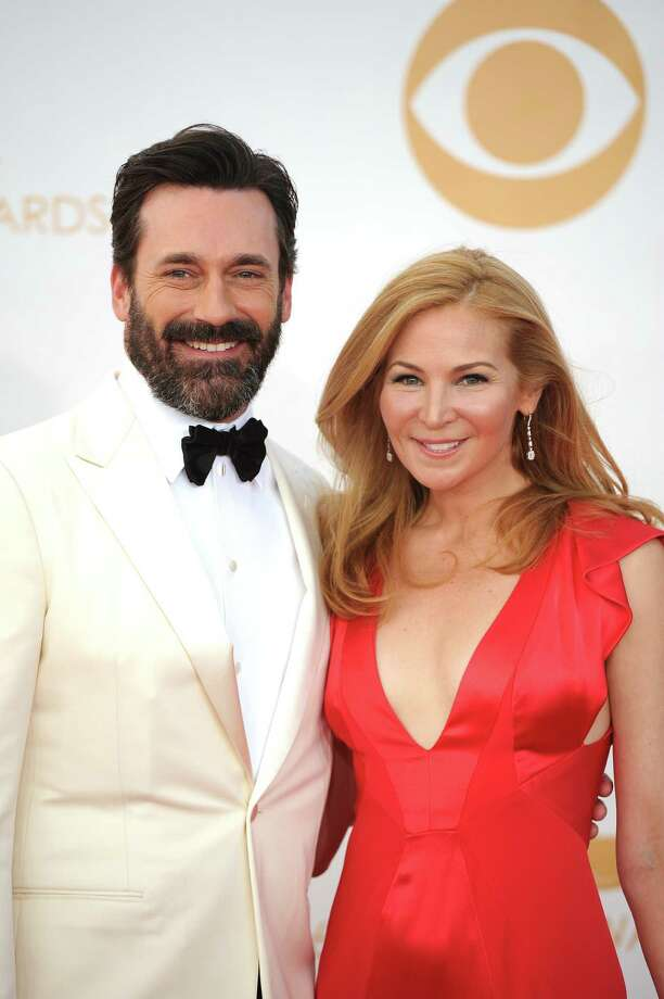 Actor Jon Hamm and partner Jennifer Westfeldt attended the 65th Emmy Awards on Sunday. Hamm showed up sporting a full beard. Photo: ROBYN BECK, Staff / AFP