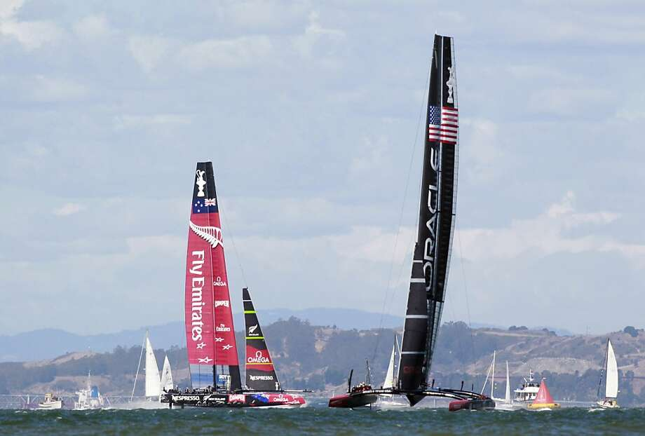 Oracle Team USA (right) leads Emirates Team New Zealand on the final leg of Race 19 of the America's Cup Finals on Wednesday, September 25, 2013 in San Francisco, Calif. Photo: Beck Diefenbach, Special To The Chronicle