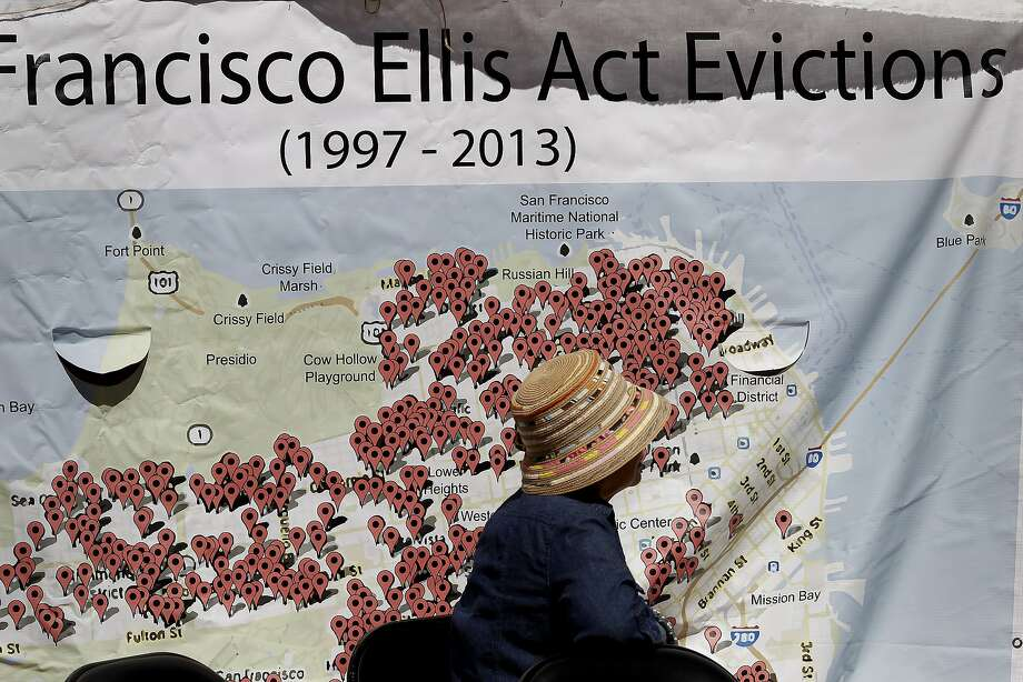 A woman sat in front of a large chart showing the numbers of evictions because of the Ellis Act since 1997 Wednesday September 25, 2013 in San Francisco, Calif. The Lee family has lived on Jackson Street in San Francisco for decades and now is being evicted under the Ellis Act. Friends, politicians and religious leaders gathered at their home to show their support for the elderly couple and stand against evictions of longtime residents. Photo: Brant Ward, The Chronicle