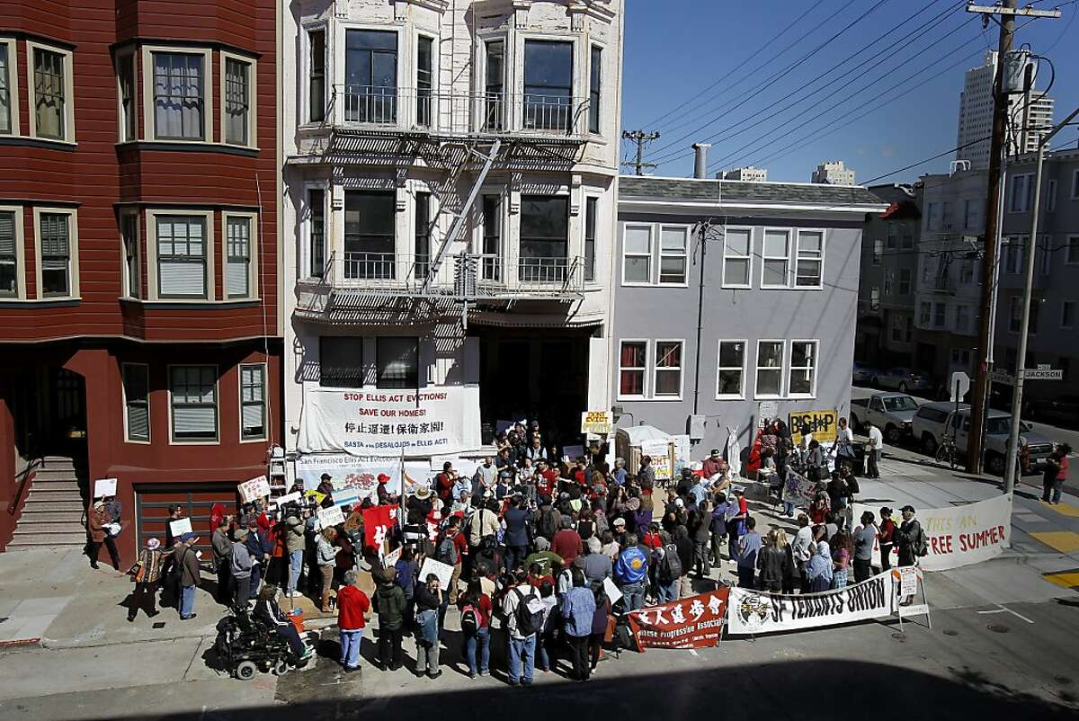 Over one hundred supporters gathered in front of the Lee's building on Jackson Street to support the family Wednesday September 25, 2013 in San Francisco, Calif. The Lee family has lived on Jackson Street in San Francisco for decades and now is being evicted under the Ellis Act. Friends, politicians and religious leaders gathered at their home to show their support for the elderly couple and stand against evictions of longtime residents.