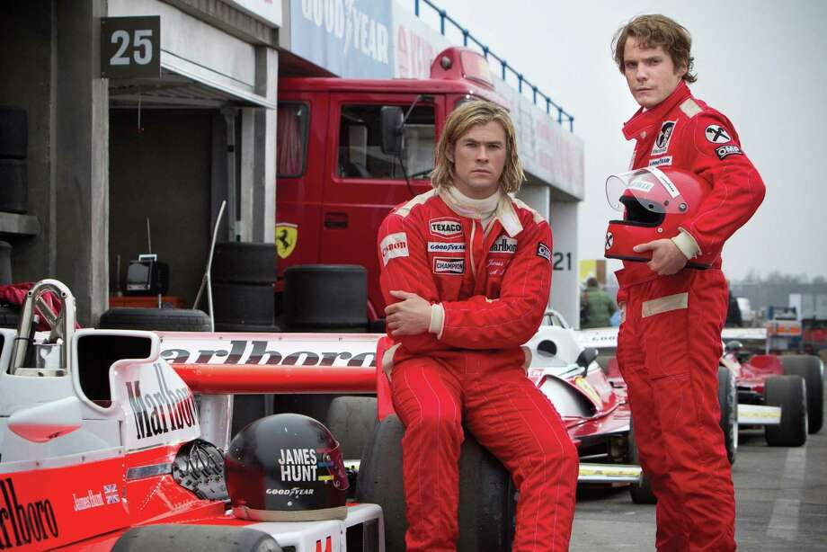 "Chris Hemsworth (left) and Daniel Brühl co-star as fiercely competitive Formula One drivers James Hunt and Niki Lauda, respectively, in ""Rush."" Photo: Jaap Buitendijk / McClatchy-Tribune News Service"