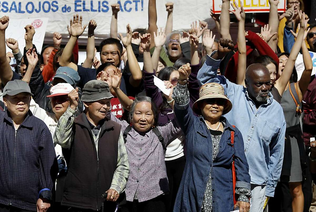 Over one hundred supporters of the Lee's and shouted against elderly evictions Wednesday September 25, 2013 in San Francisco, Calif. The Lee family has lived on Jackson Street in San Francisco for decades and now is being evicted under the Ellis Act. Friends, politicians and religious leaders gathered at their home to show their support for the elderly couple and stand against evictions of longtime residents.