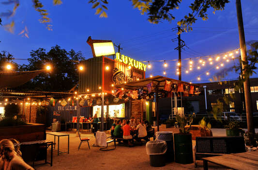 All of the seating at The Luxury is outdoors. The kitchen and bar operate out of repurposed cargo containers. Photo: Express-News File Photos