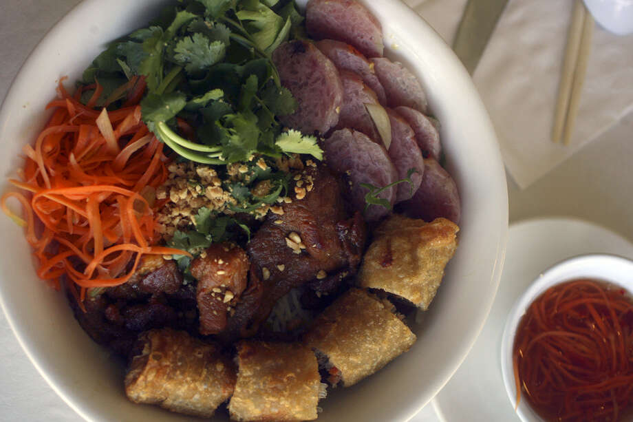 Vermicelli with grilled pork, spring roll and pork sausage at Pho Thien An. Photo: Express-News File Photo