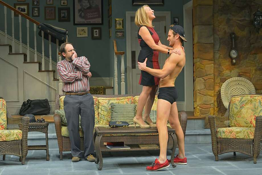 """Masha (Lorri Holt, center) shows off her relationship with the young Spike (Mark Junek, right) as her brother Vanya (Anthony Fusco) watches in """"Vanya and Sonia and Masha and Spike"""" at Berkeley Repertory Theatre Photo: Kevin Berne"""
