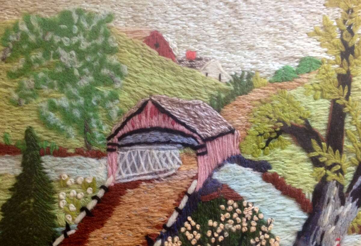 """A detail from a """"worsted-embroidery"""" picture by Grandma Moses, titled and signed """"Old Bennington Bridge."""" (From the Edna Margaret Woodcock estate. Copyright Grandma Moses Properties Co., New York.)"""