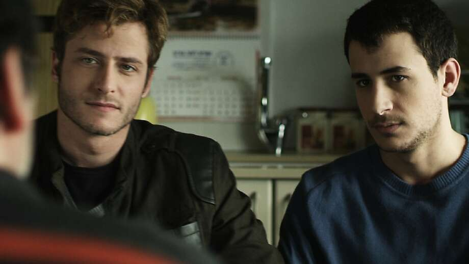 Michael Aloni (left) is an Israeli lawyer and Nicholas Jacob a Palestinian student who fall in love, and their romance plays out amid the Mideast conflict. Photo: Breaking Glass Pictures