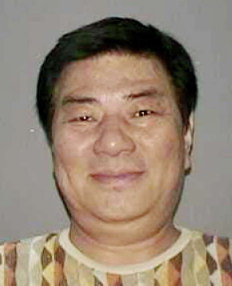 In this undated photo provided by the Nassau County Police Department in Mineola, N.Y. on Wednesday, Sept. 25, 2013, a New York State Driver's License photo of Sang Ho Kim is shown. Police say that Kim walked into a suburban light fixture company where he had done business as a vendor and opened fire Wednesday, killing one employee, wounding another person and leading to the lockdown of a nearby mall. Police said that Kim fled the scene in a white SUV. (AP Photo/Nassau County Police Department) ORG XMIT: NYR102 / Nassau County Police Department