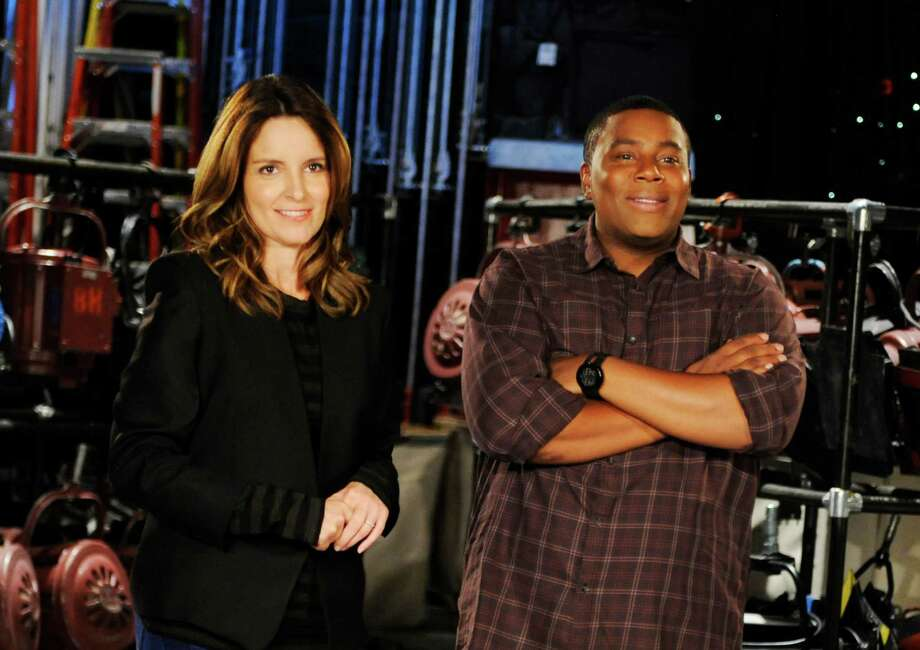 "This Sept. 24, 2013 photo released by NBC shows Tina Fey, left, and Kenan Thompson on the set of ""Saturday Night Live,"" in New York. Fey, a former cast member, will host the season opener of the popular late night sketch comedy show on Sept. 28. (AP Photo/NBC, Dana Edelson) Photo: Dana Edelson, HOEP / NBC"