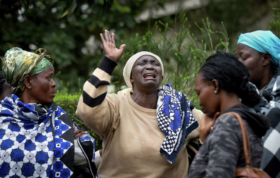 Relatives grieve for victims of Saturday's attack by gunmen at a shopping mall in Nairobi. The siege was in retaliation for Kenya sending troops into Somalia. Photo: Ben Curtis, STF / AP
