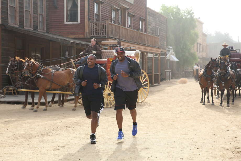 "Former NFL  teammates Chester Pitts, left, and Ephraim Salaam make their way to the starting line on the new season of ""The Amazing Race."" Contestants will face challenges in Iquique, Chile, then move on  to Norway and Abu Dhabi. Photo: Courtesy Photo, STR / �©2013 CBS BROADCASTING INC. All Rights Reserved."