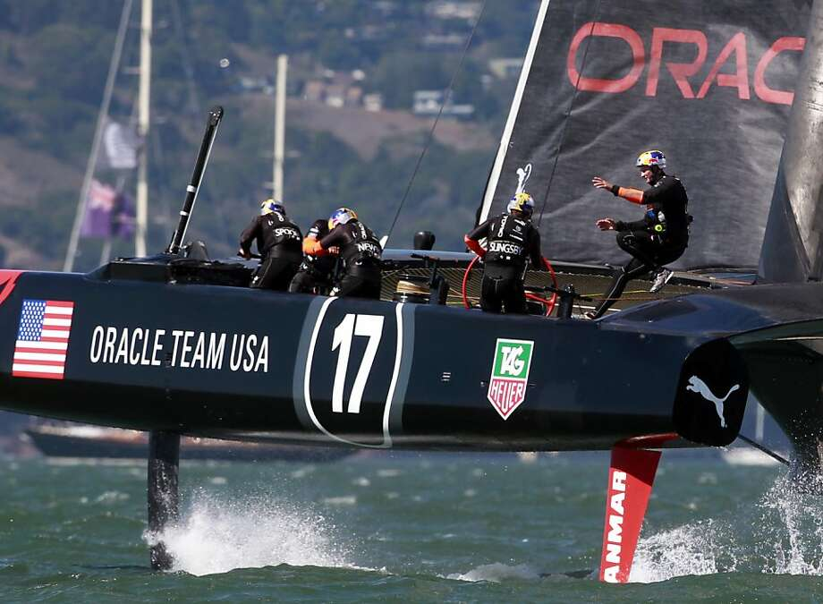 Oracle Team USA sailors perform a tack while heading to the leeward gate of Race 19 of the America's Cup Finals on Wednesday, September 25, 2013 in San Francisco, Calif. Photo: Beck Diefenbach, Special To The Chronicle