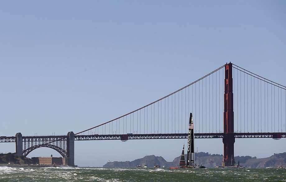 Oracle Team USA pulls ahead at the leeward gate of Race 19 of the America's Cup Finals on Wednesday, September 25, 2013 in San Francisco, Calif. Photo: Beck Diefenbach, Special To The Chronicle